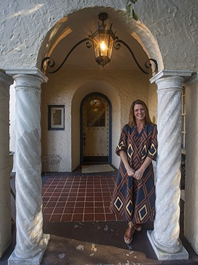 Christy Lantz, at the entrance to her 1920s Mediterranean-style home on Monument Avenue, says the architecture reminded her of her South Florida roots when she and her husband purchased the house. - SCOTT ELMQUIST