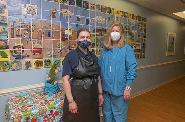 Ann Marie Chevalier with her job coach, Bethany Moog-Ayers, at Bon Secours St. Mary's Hospital. - SCOTT ELMQUIST