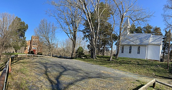 Little remains at Columbia, a once thriving community along Route 6 at the confluence of the James and Rivanna rivers, but St. John's Episcopal Church, at left, and St. Joseph's Catholic with the Shrine ofSt. Katharine Drexel have still-active congregations. - SCOTT ELMQUIST
