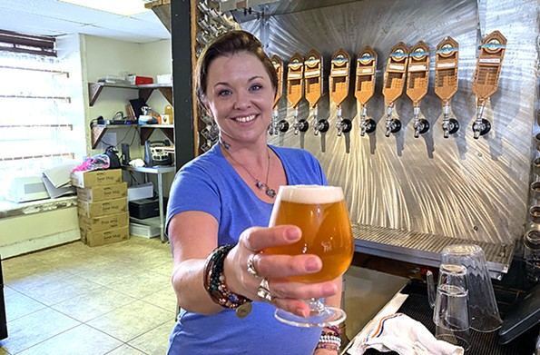 Scottsville native Jacqueline Payne, a bartender at the James River Brewery on Valley Street, serves up a glass. - SCOTT ELMQUIST