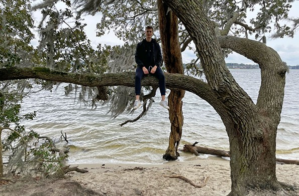 Kulusic is out on a limb at First Landing State Park. - PHOTO COURTESY DOMINIK KULUSIC