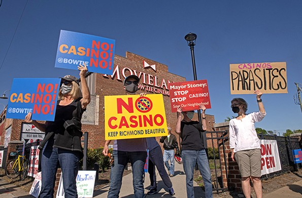 Protesters shout at passing cars on Arthur Ashe Boulevard in front of Movieland at Boulevard Square. - SCOTT ELMQUIST