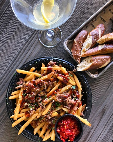 Dirty Fries include pulled pork, Mama Lil's peppers, garlic,parsley and steak sauce at Drive Shack Richmond. - @TAYTRIESCHEESEFRIES