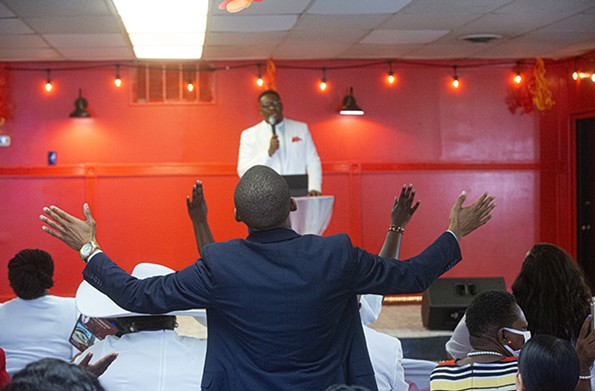 """Love Cathedral congregants wear all white to celebratePentecost on Sunday, May 23. The Rev. Donte McCutchen shares the story of the Holy Spirit descendingupon the twelve disciplesin Jerusalem: """"Pentecost happens every time change takes place and we unify,"""" he says. - SCOTT ELMQUIST"""