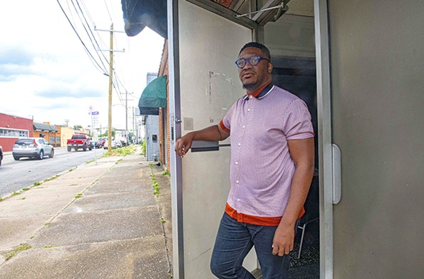 McCutchen stands in the doorway of his Hull Street church; a mere mile away the Belt Atlantic Apartment shootings took place in late April, claiming the lives of two of McCutchen's relatives. - SCOTT ELMQUIST