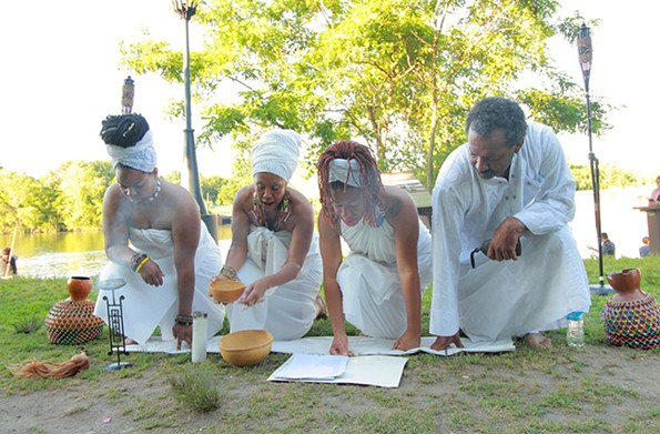 Members of Elegba Folklore Society performing a libation ceremony.