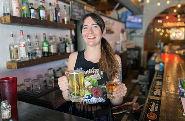 Bartender Rachel Pruett holds a mug and a shot at Town Hall. - SCOTT ELMQUIST