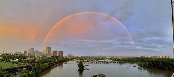 A gorgeous double rainbow arcs over the city.