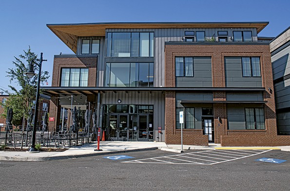 The cantilevered roof of a City View building in the 500 block of Hull Street, designed by 3North Architects, sheltersapartmentsand a just openedContinental Manchester restaurant and Stella's Market. - SCOTT ELMQUIST