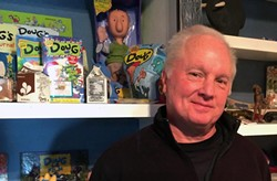 "Jinkins stands in front of some Doug merchandise. At one point, a live ""Doug"" show ran at Walt Disney World. - JIM JINKINS"