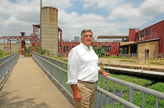 On the Richmond flood wall near the Caraustar printing plant, Rick Gregory's Fountainhead Development plans to build a 93-unit complex called South Canal Lofts. - SCOTT ELMQUIST