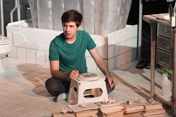 "David (Denver Crawford), is a 20-something crippled by OCD who decides to take up residence in his mother's bathroom in the musical ""The Boy in the Bathroom."""
