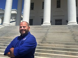 Kevin Erskine, who is building Coelacanth Brewing in Norfolk, stands for a photo in front of the state Capitol after speaking to lawmakers in Richmond on Thursday, Aug. 13, 2015, about the need to clarify regulations for the state's burgeoning brewery industry. - PATRICK WILSON | THE VIRGINIAN-PILOT