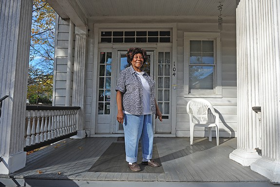Longtime resident Rosalind Jones stands on her porch in Battery Park.