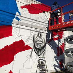 A look at the second mural of Sanders underway by artist Hamilton Glass.