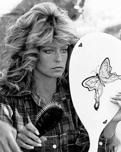 Farrah Fawcett with big hair in a publicity shot.