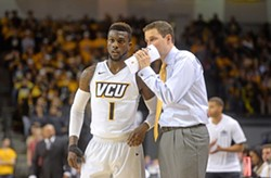 Point guard Jequan Lewis and VCU Coach Will Wade.