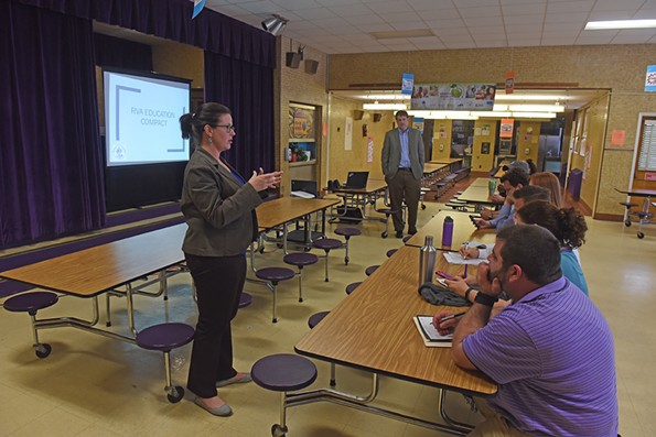 City Council member Kristen Larson and Thad Williamson from the city present the mayor's education compact to a group of people at Westover Hills Elementary School on Apr. 5. - SCOTT ELMQUIST