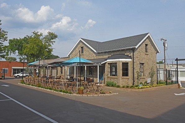 The former city horse stables in Scott's Addition, now Blue Bee Cider, was a hot property when plans to sell it surfaced in 2014. - SCOTT ELMQUIST