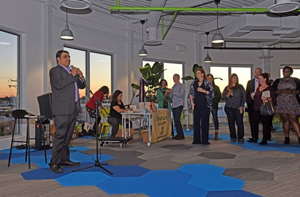 Farzad addresses the crowd at his Richmond book launch party Oct. 17. The Miami- themed party was hosted by Fountain Bookstore and was held at Dominion Payroll's headquarters in Scott's Addition. - SCOTT ELMQUIST