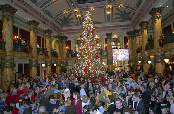Holiday visitors make merry in the rotunda of the Jefferson Hotel for the lighting of its Christmas tree. The festivity occurs Nov. 27 this year. - SCOTT ELMQUIST