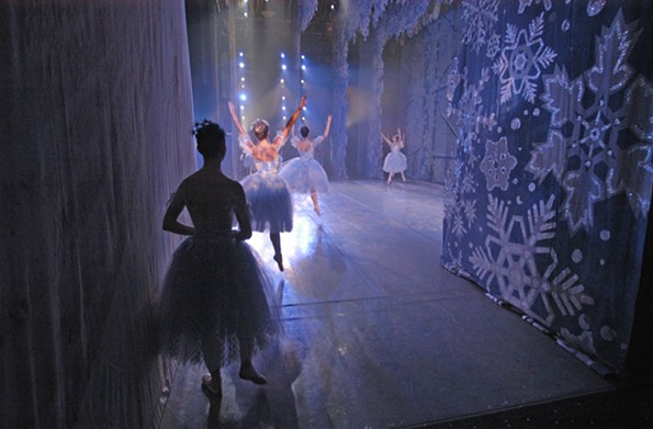"A dancer in the Richmond Ballet ""The Nutcracker"" awaits her cue to join the other snowflakes on stage. The Peter Tchaikovsky favorite has been performed here since 1963. - SCOTT ELMQUIST"