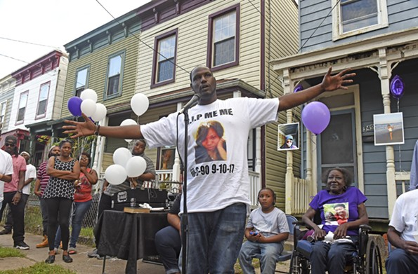 Carlton Smith remembers his sister at a vigil in Richmond's East End. Jenelle Smith, 26, was murdered in Gilpin Court on Sept. 10. - SCOTT ELMQUIST