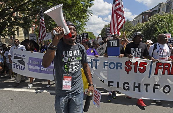 In August 2016, Stacey Stitt led minimum wage protesters on Monument Avenue in a fight for an increase to $15 an hour. Democrats are pushing for wage reform in this year's General Assembly. - SCOTT ELMQUIST