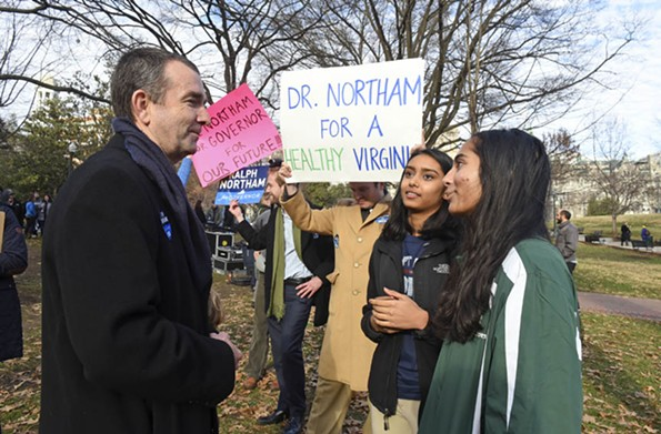 Then-Lt. Gov. Ralph Northam greets supporters Shreya Dwibedy and Shaila Lothe from Henrico High School last year. - SCOTT ELMQUIST