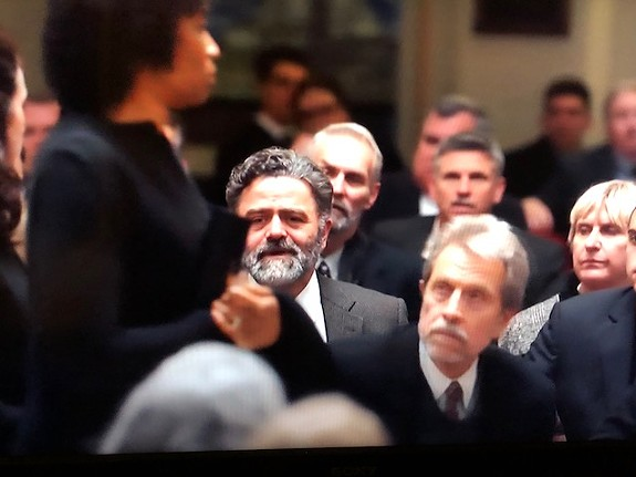 "Local actor and musician Mike Marunde (beard) shouts down a mourner in ""Homeland."""