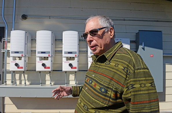 Joseph Jeeva Abbate, who heads the retreat's energy program, shows off solar gear at Yogaville. - SCOTT ELMQUIST