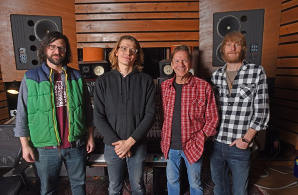 Keyboardist and bandleader Daniel Clarke, engineer and guitarist Adrian Olsen, singer and pianist Steve Bassett, and drummer Dusty Ray Simmons stand inside Montrose Recording studio just north of Richmond. - SCOTT ELMQUIST