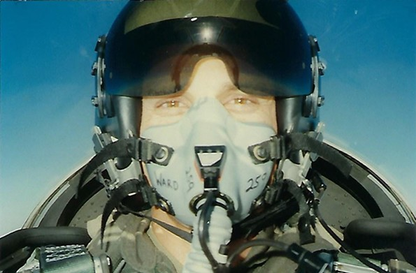Ward is shown in a jet cockpit as a Marine Corps combat pilot.