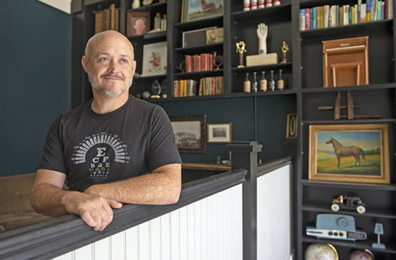 Director Dave Jackson stands inside Black Iris Gallery, whose sprawling three floors recently became a social club that hopes to provide a safe and diverse place for members.