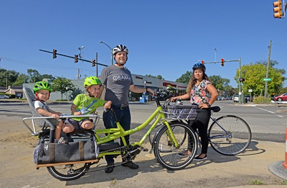The director of Bike Walk RVA, Max Hepp-Buchanan, with Aksel, 2, Lars, 5 and the lead organizer of Bike Walk RVA, Louise Lockett.