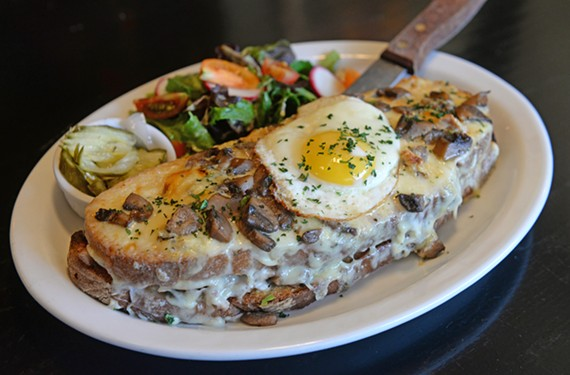 The Alice and the Caterpillar sandwich features blue cheese and wine-braised rabbit on sourdough with mushroom bechamel and a fried egg.