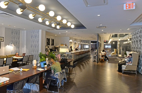 Brookfield, the bar and coffee shop at the Graduate Richmond, features white tile and clean lines.