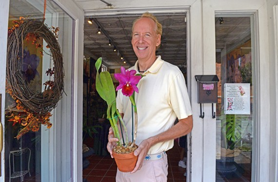 Art Chadwick Jr. stands in front of his store, Chadwick & Sons Orchids, at 203 N. Belmont Ave., with a gift for the first lady.