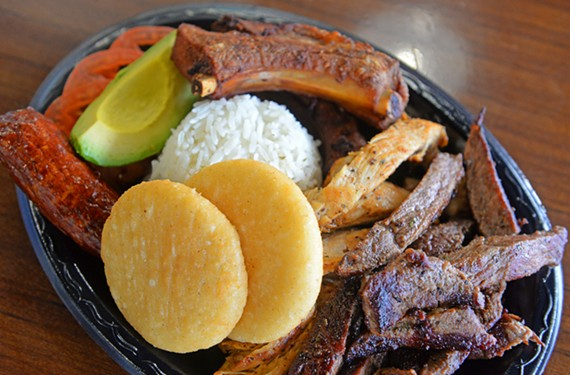The parilla at Bocata Latin Grill is a mixed platter of ribs, chorizo and rice with avocado and arepitas.
