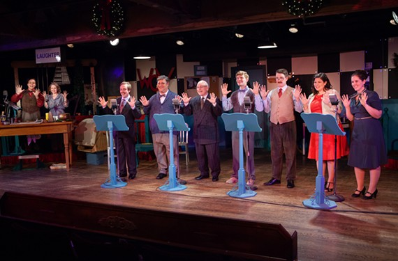"The harmonizing ensemble cast of ""A 1940s Radio Christmas Carol"" performs a radio show within the play."