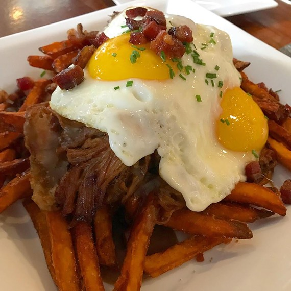 Brunch's twist on poutine features sweet potato fries, redeye gravy and pulled pork.