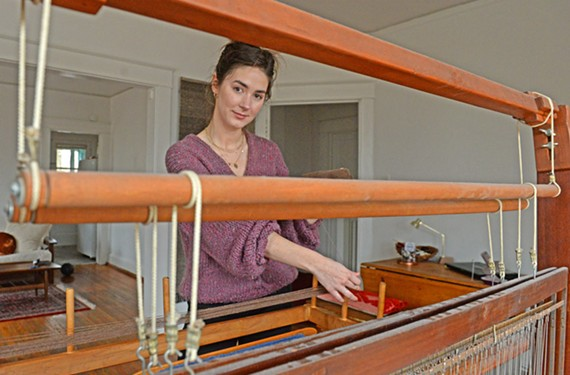 Misti Nolan deconstructs a cashmere sweater on a weaving loom at her home in Richmond. She's recycled well more than 420,000 yards of natural fiber sweaters back into yarn.