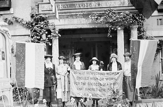 Alice Paul, chairman, and officers of the National Womans Party in front of the Washington headquarters before leaving for the Chicago Convention to take charge of the suffrage attack on the Convention of the Republican Party. Left to Right Miss Sue White, Nashville, Mrs. Benigna Green Kalb, Houston, Mrs. Jas Rector of Columbus Ohio, Miss Mary Dubrow, N.J., Alice Paul and Miss Elizabeth Kalb of Texas.