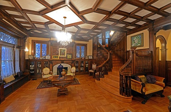 The foyer at 2710 Monument Ave. features decades-old wood brought back to life after years of vacancy. The current owners are seasoned renovators.