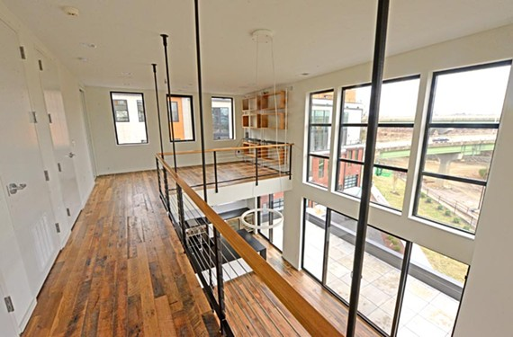 The James River is a centerpiece of this town house in Richmond's Manchester. Gorgeous views are available through much of the four stories of the home, loaded with open spaces. The ceiling is about 20 feet high in the living room.