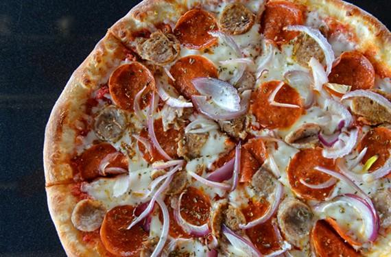 Pepperoni, sausage and red onion top the pizza carnivora at Amici di Enzo.