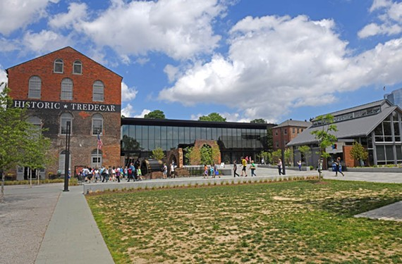 The recently-completed American Civil War Museum appears architecturally as a sheer glass connector between buildings that once comprised Tredegar Ironworks. The building at right was built in 2005 as an entrance pavilion to the foundry building.