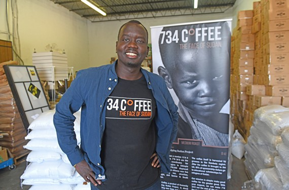 Manyang Kher, 30, of Henrico County, is a Sudanese Lost Boy refugee and founder of 734 Coffee, launched in 2016 as a small operation. It's now slated to become a multimillion dollar operation supporting Sudanese refugees. Here he stands in his warehouse in Springfield.