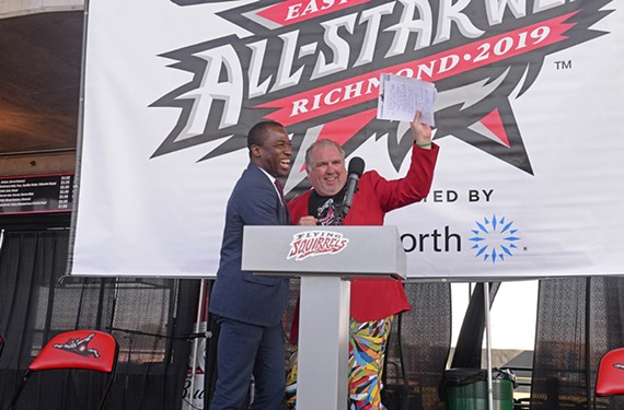 "Mayor Levar Stoney stands at a podium at the Diamond with Richmond Flying Squirrels Vice President Todd ""Parney"" Parnell during the announcement of All-Star Week in October."
