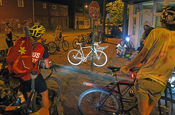 Friends of Robyn Hightman place a ghost bike at 27th and Marshall streets in front of WPA Bakery. Well-respected in the local cycling community, Hightman was killed while working as a bike messenger in New York on June 24.